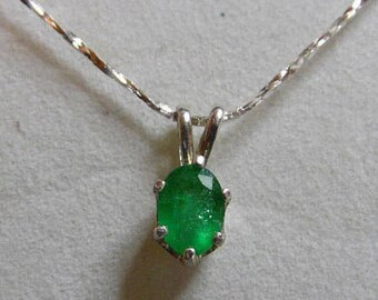 "Columbian Emerald necklace.  8x6mm oval  weighing 1.10ct.  Set in .925 Sterling Silver with 18"" .925 Sterling Silver chain."