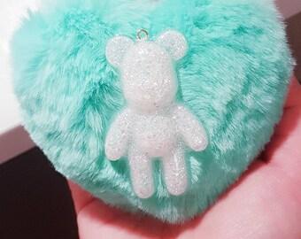 AB rainbow glitter teddybear with a aqua fluffy heart in a keychain