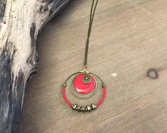 Red and bronze necklace with bolts.