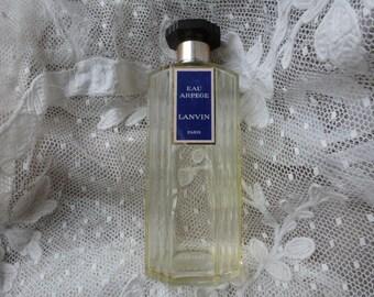 Vintage perfume bottle eau Arpege Lanvin Paris. 6  inches.