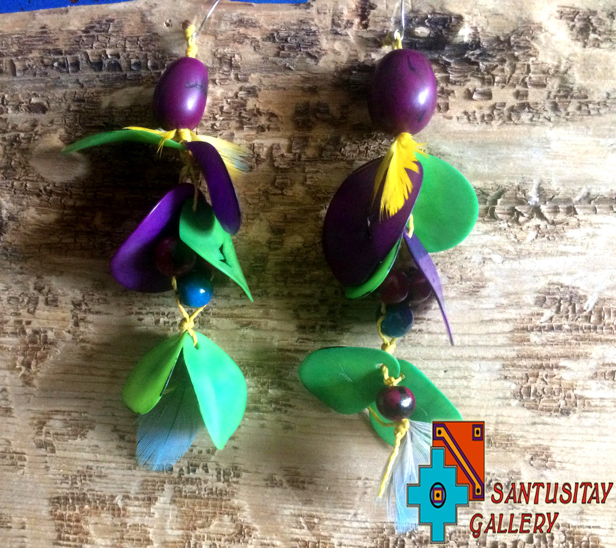 Acai tagua seeds Macau feathers hand crafted earrings hand made purple yellow teal macrame natural jungle forest tribal gift