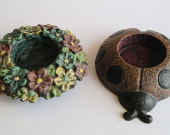 A pair of unique tea light candle holders floral and lady bird design