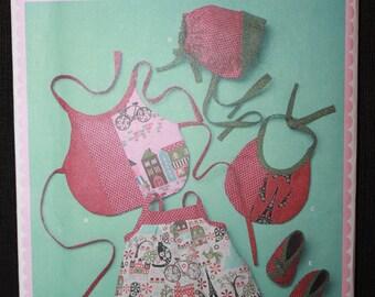 Simplicity 1794   Babies Dress, Bib, Hat and Booties