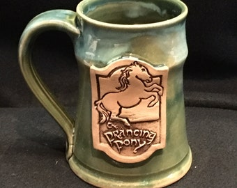 Prancing Pony inspired mug, 16 ounces, flux over green glaze