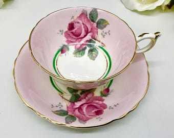 Paragon Double Warranted teacup and saucer with large cabbage roses.