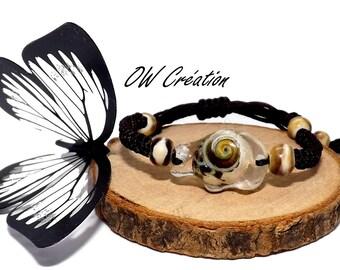 Bracelet child shell in a resin bear