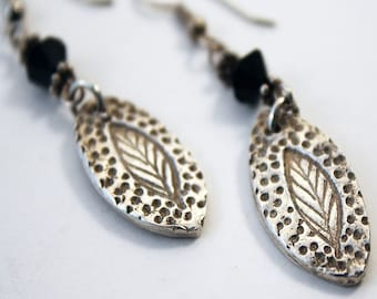 Precious metal clay leaf earrings with black crystals