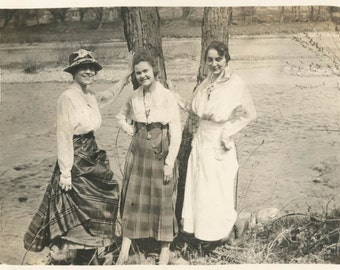 Vintage Snapshot photo 1917 Young Women Lean Tree at River Plaid Skirts