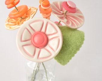 pink and orange button flower bottle bouquet