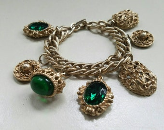 Green with Envy! Etruscan Style Gold Tone Charm Bracelet.