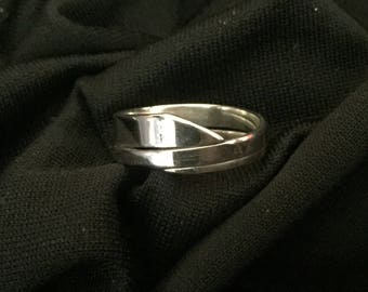 Sterling silver one of a kind wrap around band size 7 1/2
