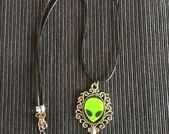Alien in mirror necklace.