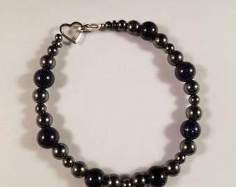 7.5 Inch hematite and natural blue gemstone bracelet.