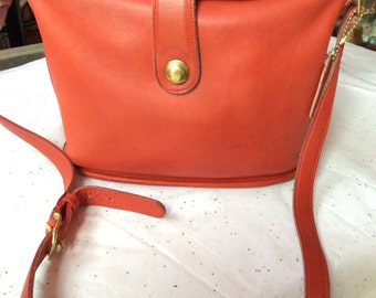 Bright red leather Coach purse
