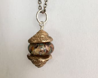 Bronze Shell Capped Glass Artist Bead On Sterling Silver Chain