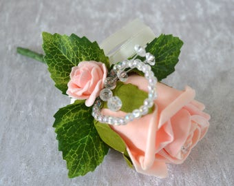 Wedding. peach rose corsage,Ladies,guest, mother of the bride. occasion, soft touch peach roses,crystal sprig.foliage leaves.pearl pin.
