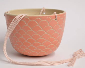 Hanging planter in coral with sgraffito