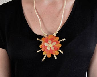 Orange flower necklace made of cut paper