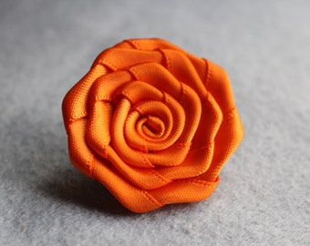 Orange flower lapel pin