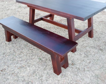 Leaning Post dining table with steel band ends