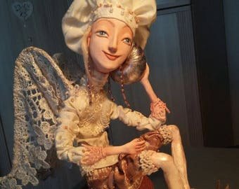 Angel with a sea shell, skeleton doll zapekaemyj Plastic