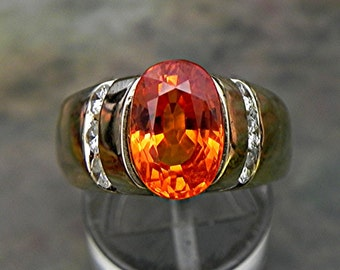 AAAA Spessartite Mandarin Orange Garnet   11x8mm  4.57 Carats   14K  Yellow Gold ring with .65 ct diamonds 1621 MMD