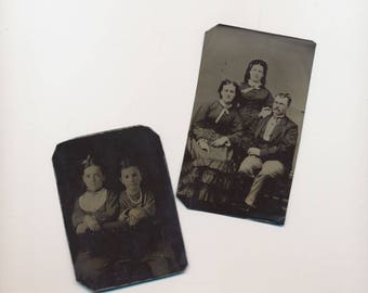 two tintype photographs, man and two women, two girls, antique