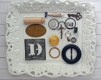 bITs KitS No041g -tin stencil, key, chandelier crystal, buckle, plane, wood needle case, doll leg, token, clock face, button, metal label