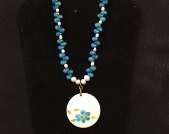 Pearl and blue beaded necklace with flower focal point