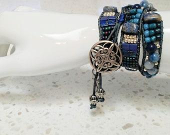 Handmade one of a kind blue beaded 3 wrap bracelet with charms