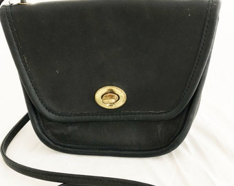 COACH - Small black leather travel crossbody messenger