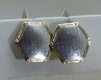 Platinum and 14kt. Gold cuff links