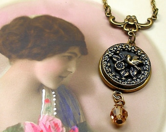 1800s BUTTON necklace, Victorian BIRD on brass chain. Antique button jewellery.