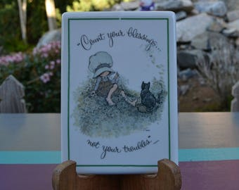 """HOLLY HOBBIE """"Count your blessings...not your troubles"""" Porcelain Plaque"""