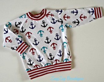Anchors away!  Crisp and colourful long sleeve tee in organic cotton jersey.  Size 6- 12 months.