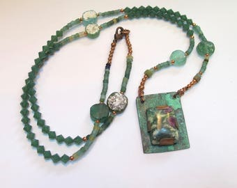 Necklace with  swarovski and roman glass beads.   handmade,    one of kind