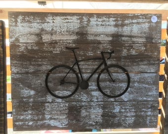 Bicycle silhouette carved in  wood