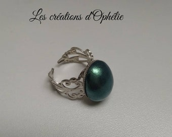 Green ring made of polymer clay.