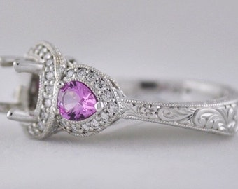 Diamond and pink sapphire three stone ring