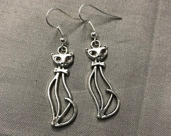 Poised cat earrings