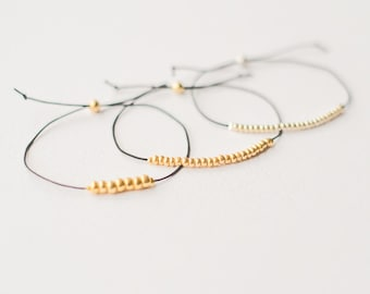 Set of 3 cord bracelets with silver and gold beads