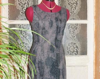 Little sleeveless dress, gray turquoise patterned background