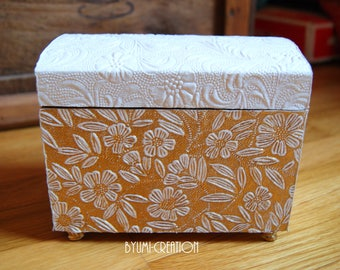 Golden flowers and white box