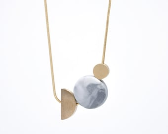 TWO MOONS // Marbled porcelain circle and bronze // necklace