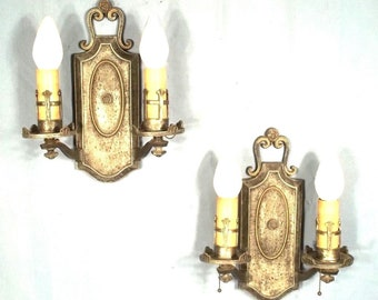 Pair Of Early 20th Century Double Arm Patinated Metal Renaissance Sconces
