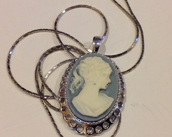 Vintage raised cameo woman with ponytail profile oval with silver tone pendant necklace