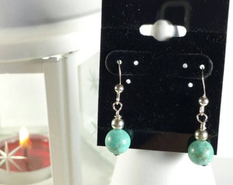 Sterling silver wire earrings with Magnesite and silver beads.