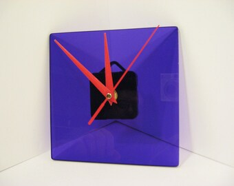 Hand made purple acrylic wall clock with red hands. Minimalist design.