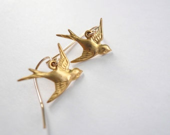 Little gold bird earrings. Brass gold birds on 14K gold fill ear wires. Dainty jewelry.