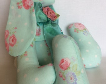 Shabby Chic handmade bunny made from aqua blue fabric printed with rose nosegays trimmed with aqua ribbon and handmade ribbon rose